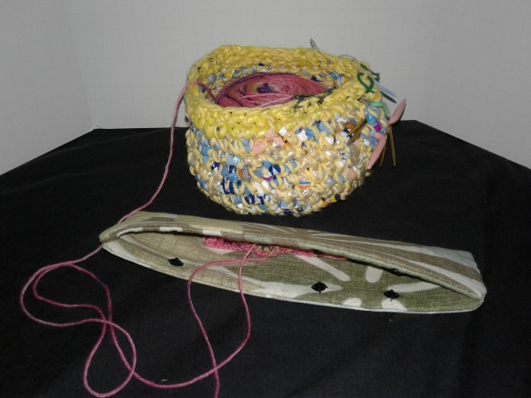 """https://handcraftermaggie.fibercrafty.com/5853-wip-work-in-progress-minder-for-dpn-and-circular.html Transport your WIP (Work in Progress) safely in a project bag and know that the stitches will be held on the needles in this WIP cozy. The size is approximately 9"""" x 2"""" and will accommodate up to about 8-1/2"""" DPNs, also circulars. The 3rd snap will keep the shorter needles from escaping the case and could keep a crochet hook secure too. I added interface to the fabric to add structure to the cozy case. The snaps are invisible from the outside, they are hand sewn. I personally like hand sewn snaps hidden inside not showing on outside. This cozy is ready to ship and is the only one I have made in this fabric that feels like a linen-cotton blend. I prewashed the fabric before making the WIP cozy. I purchased the fabric as a remnant. Waverly Inspirations Screen Print is written on the Selvage."""